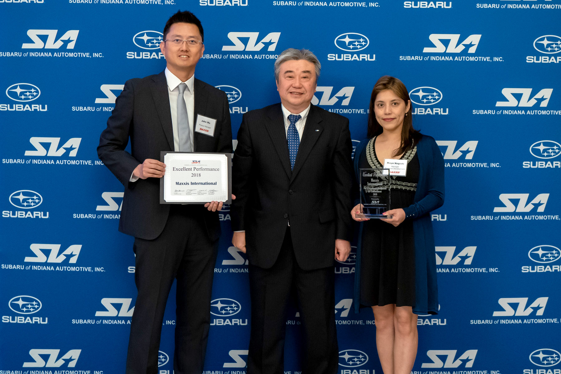 Award Photo (L-R): John Wu (Maxxis International, Product Manager), Eiji Ogino (Subaru of Indiana Automotive, Inc. (SIA), President and CEO), Maya Negishi (Maxxis International, Business Development Manager).