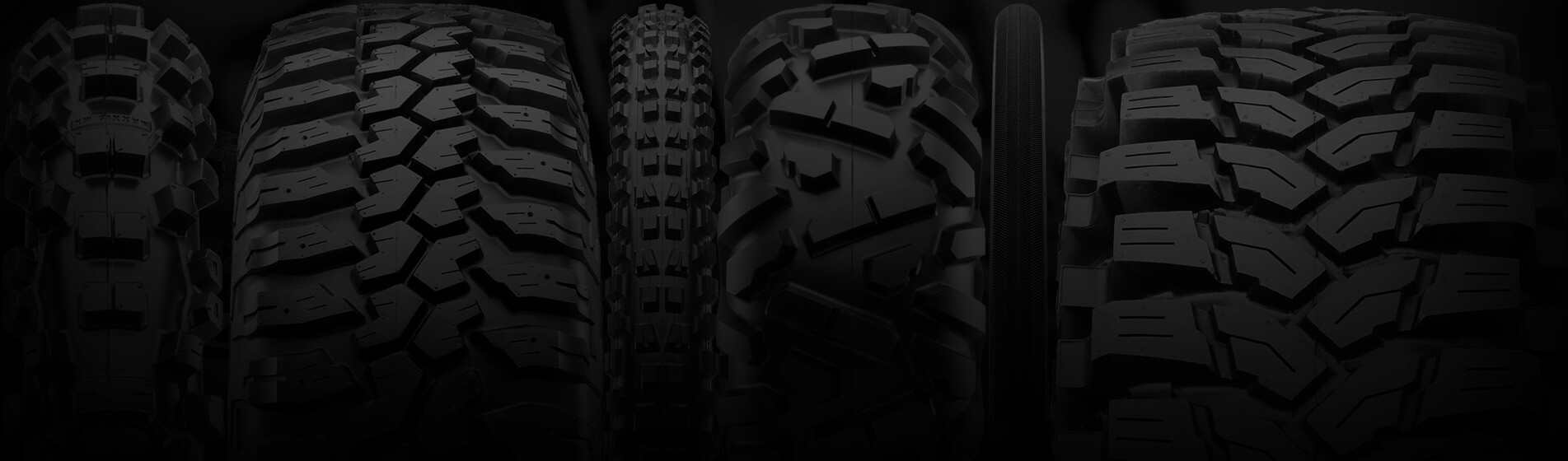 Close-up of five tires from various categories
