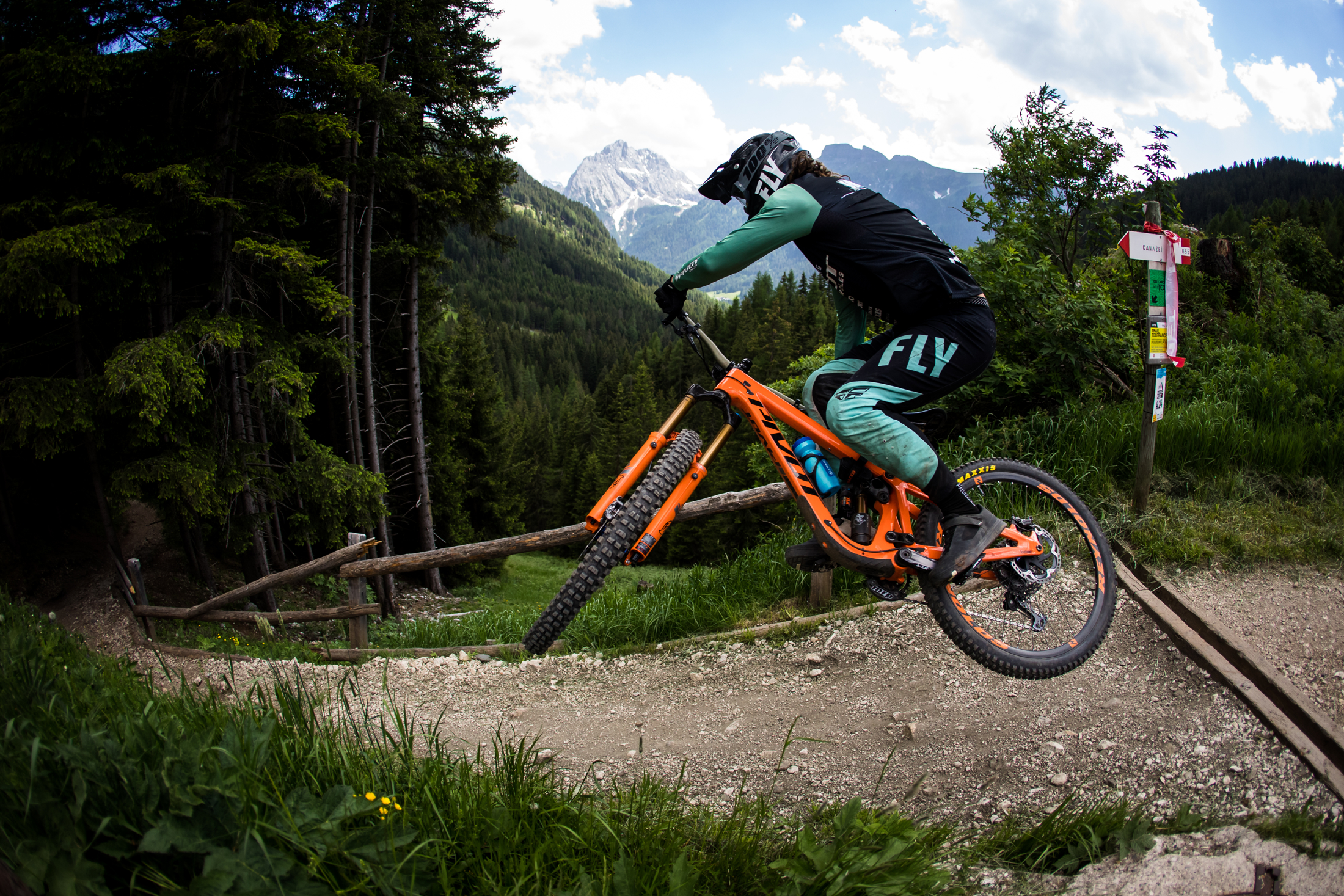 A whip tossed by a Pivot Factory Racer in front of the mountain views