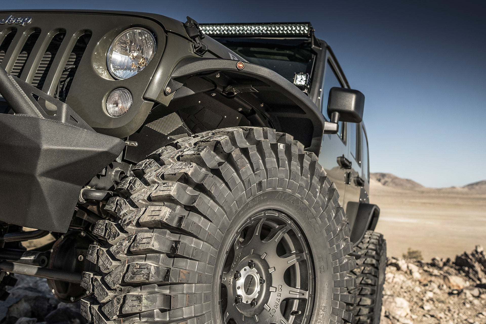 Maxxis Trepador extreme tires on vehicle in desert