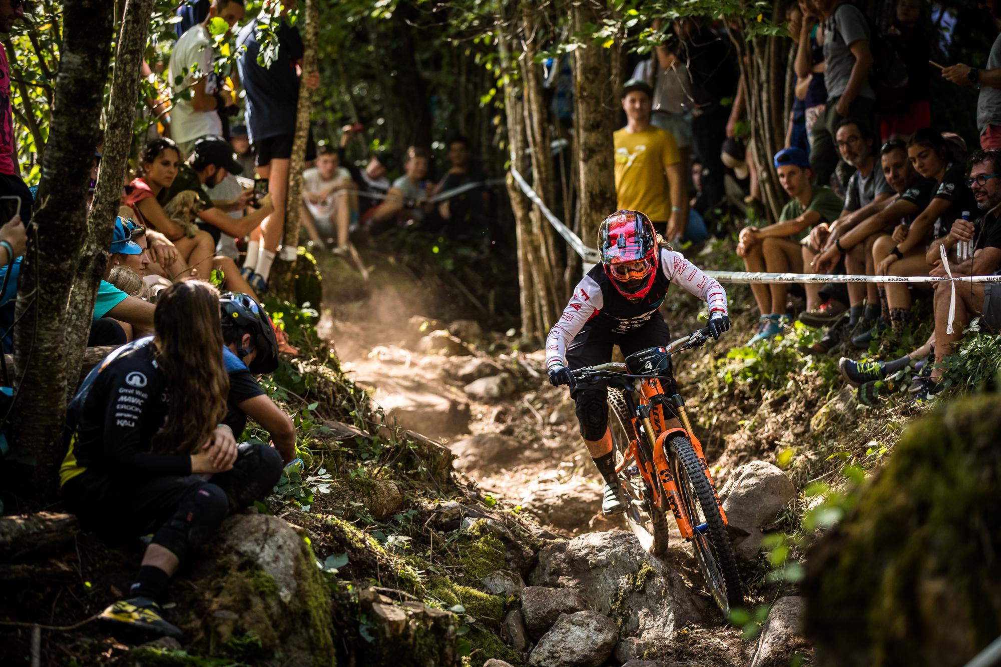 Pivot rider going through a rock garden